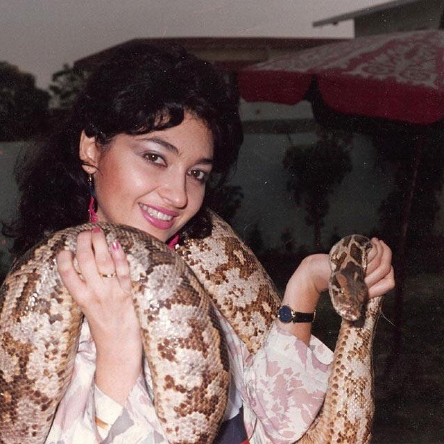 Nazan Saatci with a snake during a shoot in Pakistan