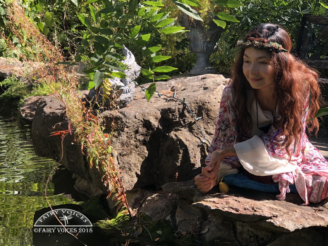 Fairy Garden Nazan Saatci with the Dragonfly Fairy, Afidouc, in 2019 posing for cameras to raise awareness